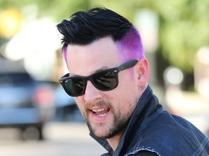 Joel Madden exits Andy Lecompte salon sporting his freshly dyed purple hair. Los Angeles, California