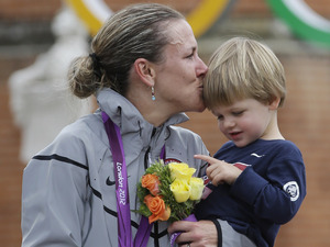 Kristin Armstrong, of the United States, kisses her son Lucas, after winning the women's individual time trial cycling event at the 2012 Summer Olympics, Wednesday, Aug. 1, 2012, in Londo