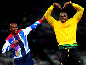 Mo Farah and Usain Bolt celebrate their gold medals and trade each other's poses on the podium.