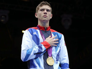Luke Campbell stands proud with his Men's Boxing Bantam 56kg gold medal.