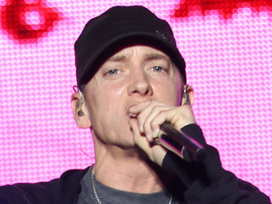 "Rap Artist performing at the 'Epicenter Twenty Ten' event in Fontana Fontana, California - 25.09.10{EMINEM} made a triumphant return to California on Saturday night (25Sep10) when he stole the show from co-headliners {KISS} at the Epicenter Twenty Ten festival in Fontana. The rapper hit the stage in dramatic fashion after a Star Wars-type script scrolled across a space-themed giant screen, calling the show the Detroit native's ""Recovery"". The cinematic note read, ""In 2005, after completing a U.S. tour, Eminem stopped performing. Eminem entered rehab, a European tour was cancelled and there were rumors that he was retiring. Over the following years, Eminem appeared to be detached and unfocused. Seldom did her return to perform live. Tonight Eminem return to the stage. You are all hear to witness Eminem's Recovery."" The rapper then ripped through a powerful hits set dotted with medleys from past crowd pleasers like My Name Is and The Real Slim Shady. He was also joined onstage by his D-12 bandmates for a tight three-song set. The huge screen above him was used to show clips from his videos, quirky animation and it was used to beam images of late pal Proof and slain rappers Biggie Smalls, aka Notorious B.I.G., and Tupac Shakur during tributes. Eminem appeared to be humbled and thrilled by the response from his California fans and treated them to an encore of Lose Yourself long after he'd thanked them for supporting him and bidding them a good night. The highlights of his 80-minute set also included renditions of Stan, Not Afraid, I Love the Way You Lie and his take on B.o.B.'s summer (10) smash Airplanes. The festival show came at the end of a month, where Eminem performed back-to-back baseball stadium shows with Jay-Z in New York and Detroit. Rockers Kiss discovered the rapper was a tough act to follow - more than half of Saturday's Epicenter audience left the arena after Eminem's show ended. Suicidal Tendencies and Blink-182 will headline the second day of the hit weekend festival on Sunday (26Sep10).Mandatory Credit: Owen Beiny/WENN.com"
