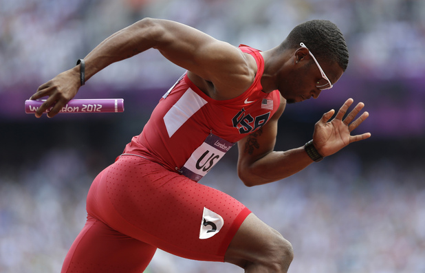 United States' Manteo Mitchell competes in a 4x400-meter relay heat during the athletics in the Olympic Stadium during which he broke his leg