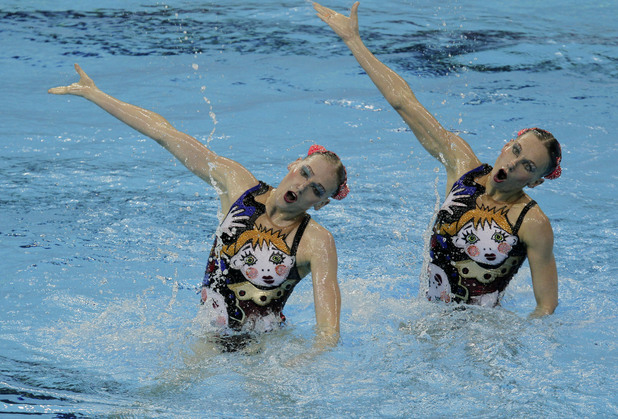 Gold medalists Natalia Ishchenko and Svetlana Romashina from Russia compete during the women's duet synchronized swimming final at the Aquatics Centre