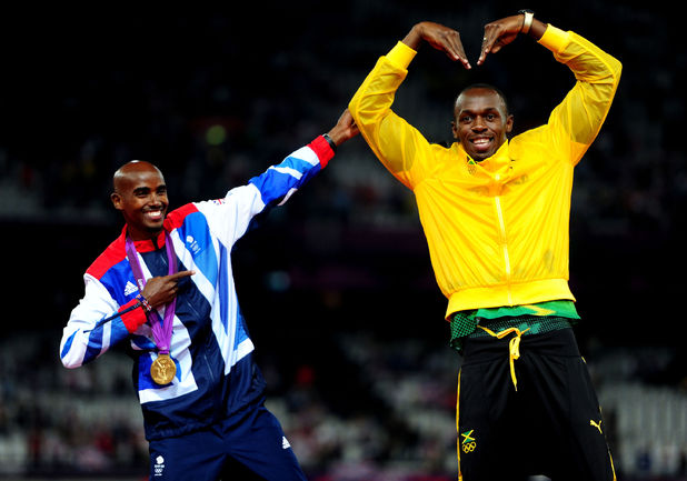 Mo Farah and Usain Bolt celebrate their gold medals and trade each other&#39;s poses on the podium.