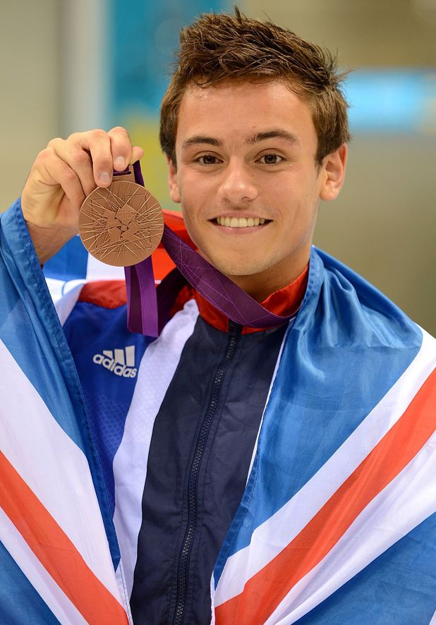 Tom Daley celebrates his bronze medal.