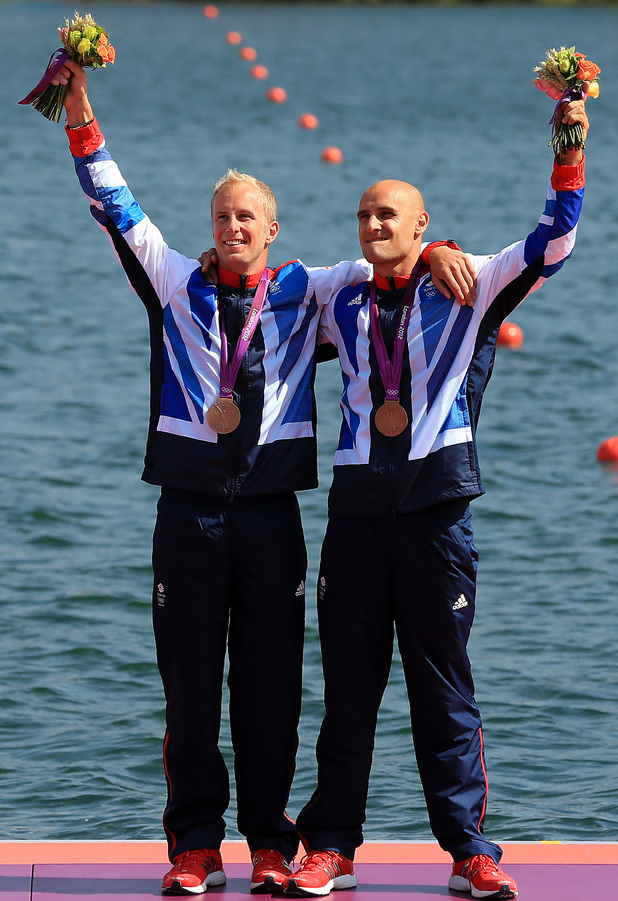 Jon Schofield and Liam Heath celebrate winning bronze in the final of the men's double kayak 200m sprint event at Eton Dorney.