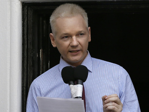 Julian Assange, founder of WikiLeaks makes a statement from a balcony of the Ecuador Embassy in London, Sunday, Aug. 19, 2012