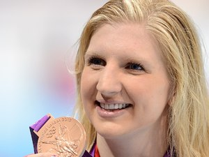 Great Britain&#39;s Rebecca Adlington celebrates with her bronze medal after finishing third in the Women&#39;s 400m Freestyle Final