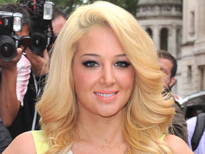 Judge Tulisa Contostavlos arriving at The X Factor press launch held at the Corinthia Hotel.