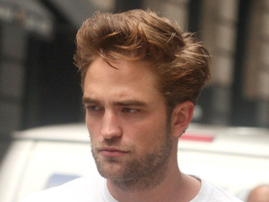 Robert Pattinson seen returning to his car exposing his blue and white underwear New York City