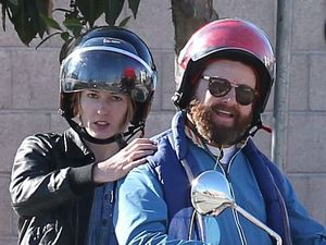 Zach Galifianakis and Quinn Lundberg on a scooter