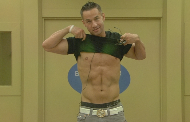 The Situation shows off his abs.