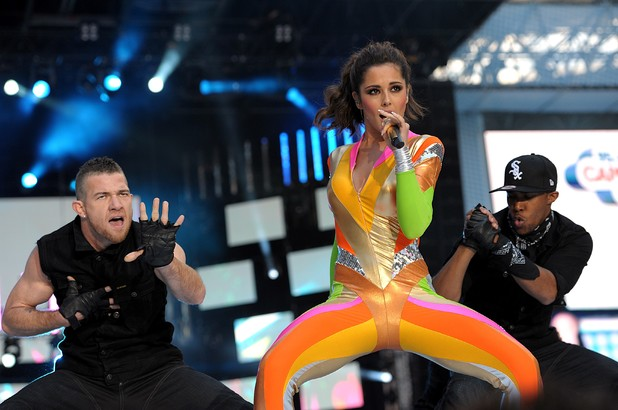 Cheryl Cole performs during Capital FM's Summertime Ball at Wembley Stadium, London.  Dating backing dancer.