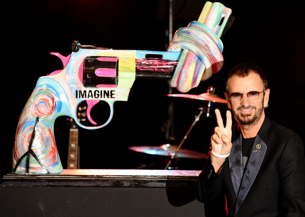 Ringo Starr, with his 'Knotted Gun' statue at the Gibson Guitar Studio, in central London.