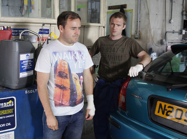 After scalding his hand with a boiling kettle, Tyrone arrives back at the garage with his hand bandaged