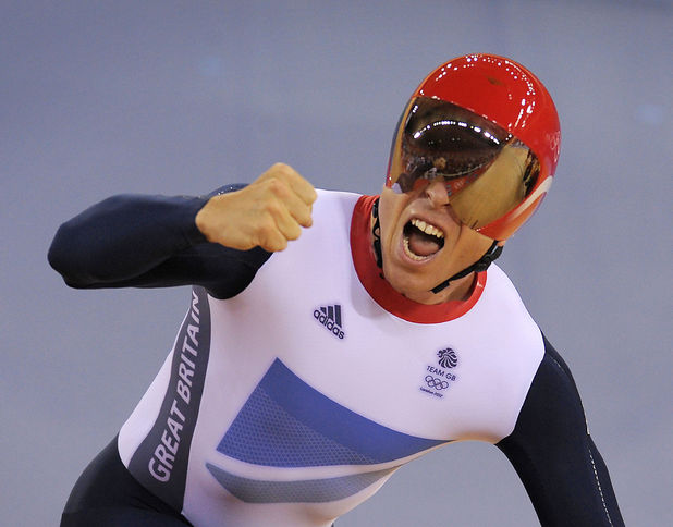 Great Britain's Sir Chris Hoy celebrates Gold in the team sprint final on the first day of the track cycling at the Velodrome in the Olympic Park.