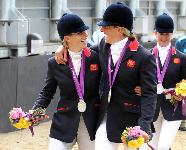 Zara Phillips, Tina Cook, Great Britain's Zara Phillips and Tina Cook celebrate with their silver medals following the Team Eventing Medal ceremony