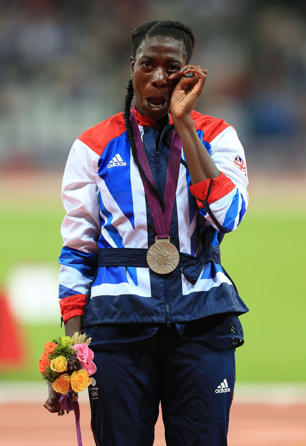 Great Britain's Christine Ohuruogu wipes away a tear as she receives her silver medal in the 400m final at the Olympic Stadium, London