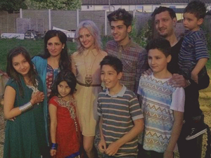 Perrie with Zayn and his family, as posted on Twitter