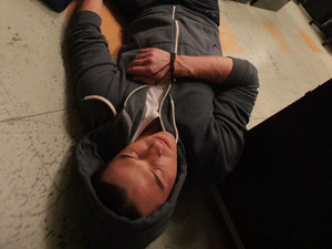 Ryan lies on the floor unconscious after being attacked by Rob