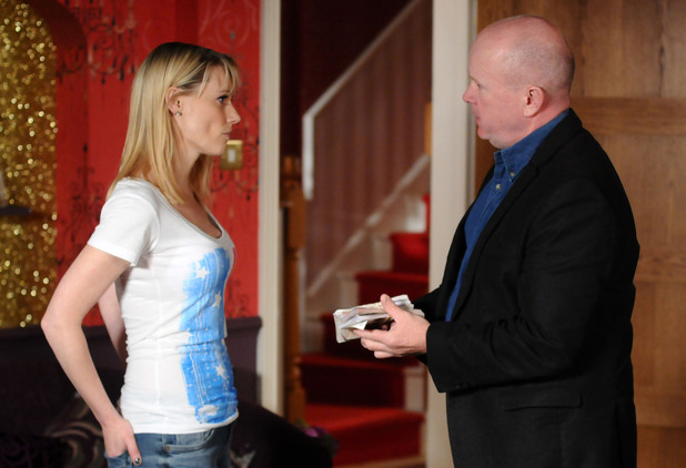 Phil offers Carly cash to stay and help Shirley sort herself out.