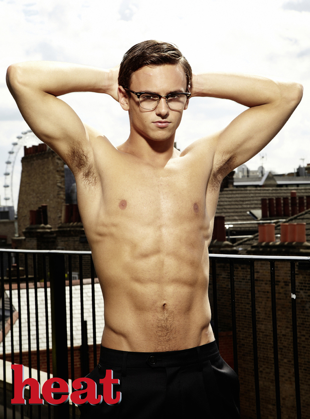 Tom Daley poses for Heat magazine