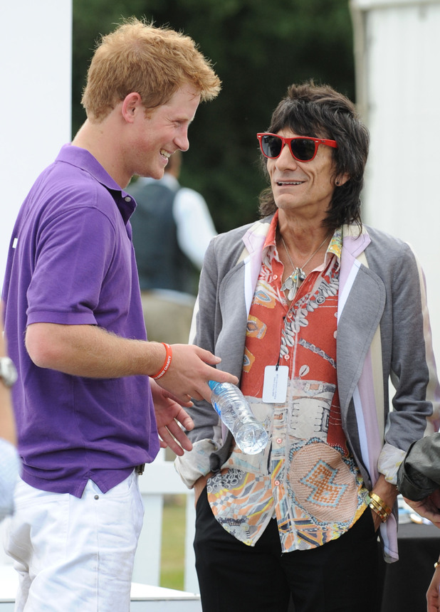 Prince Harry and Ronnie Wood during the Asprey World Class Cup at Hurtwood Park Polo Club in Surrey