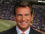  ESPN Monday Night Football television broadcast analyst Joe Theismann poses for a photo before the Oakland Raiders-Minnesota Vikings game in Minneapolis, in this Aug. 14, 2006