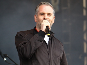 Chris Moyles appears on stage at the Reading Festival.
