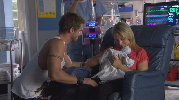 Bianca Scott holds baby Rocco in Home and Away