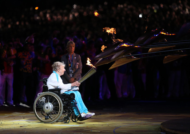 Margaret Maughan lights the Olympic flame