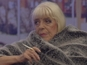 Julie Goodyear's conversation with MC Harvey is aired to her fellow housemates.