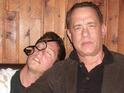 Tom Hanks poses with a fan pretending to be drunk on his shoulder.
