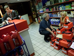 Theresa keeps the shop assistant occupied whilst Joel robs the till.
