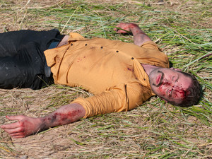 Brendan lies on the ground after the explosion.