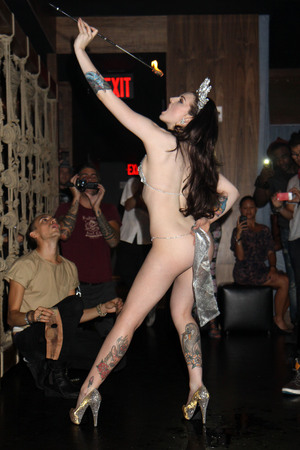 British Burlesque star Katrina Darling performed a racy dance at new downtown venue Demi Monde in New York as a kickoff to the city's Fashion Week. The performance coincides with her current Playboy cover which is on sale now in the US and UK. Her cousin Pippa Middleton is also in New York this week. It is rumoured they will both attend Fashion Week while staying in the city. New York City, USA