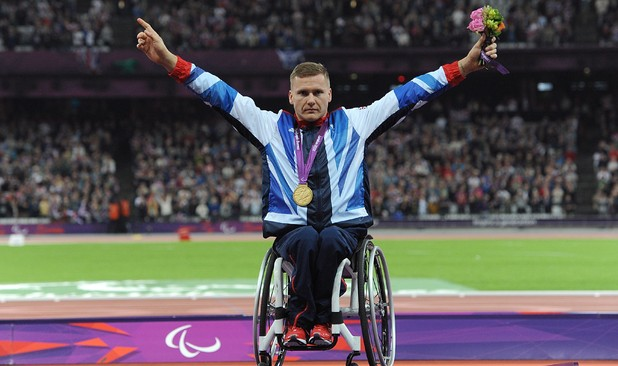 Great Britain's David Weir celebrates with his gold after winning the Men's 800m - T54