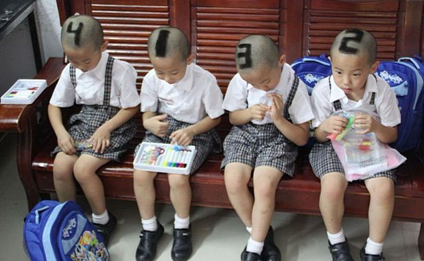 Mother has numbers shaved into hair of quadruplet sons, Shenzhen, Guangdong Province, China