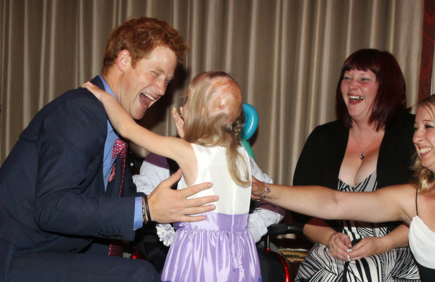 "Prince Harry meets Hope Hillis as he attends the WellChild awards ceremony InterContinental Park Lane Hotel, London. Picture date: Monday September 3, 2012. Alex, aged six, was interviewed by ITV News with his mother Debbie Logan ahead of the prize-giving event, and when asked what he would say to the royal replied: ""I'm glad you've got your clothes on Prince Harry"". See PA story ROYAL Harry. Photo credit should read: Lewis Whyld/PA Wire"