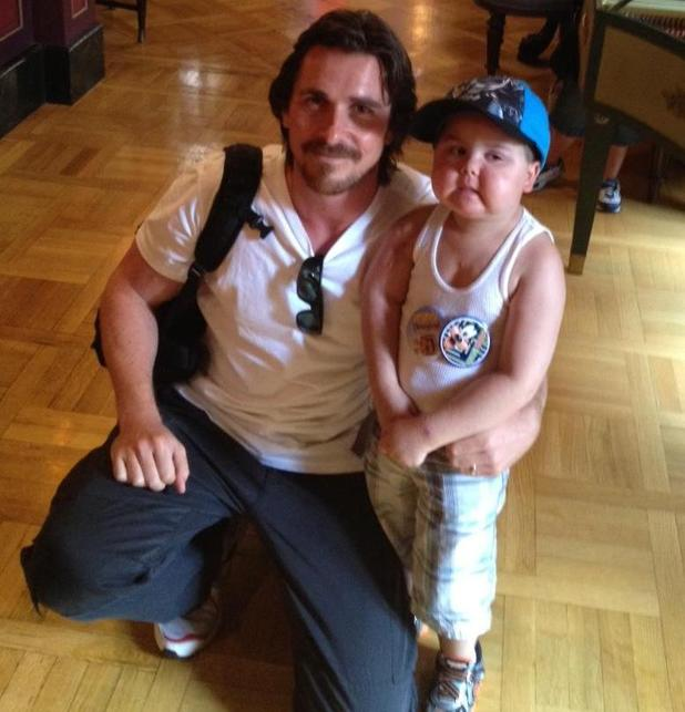Christian Bale with young fan and cancer patient Jayden.