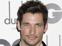 Hot model David Gandy smoulders in his suit at GQ Awards.