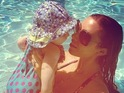 "Saturdays singer says she is having a ""lovely"" time in LA with her ""little swimmer""."
