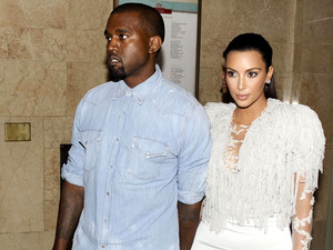 Kim Kardashian and Kanye West attend the Marchesa show at New York Fashion Week