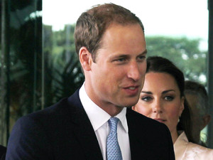 Prince William and his wife Kate, the Duke and Duchess of Cambridge, center, are greeted as they arrive at the VIP terminal of Changi International Airport on Tuesday, Sept. 11, 2012 in Singapore. The British royal couple is on an official three-day trip to Singapore. (AP Photo/Wong Maye-E, Pool)