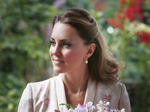The Duchess of Cambridge attends an orchid-naming ceremony during the first engagement in Singapore, as part of a nine-day tour of the Far East and South Pacific, with the Duke of Cambridge, in honour of the Queen&#39;s Diamond Jubilee.