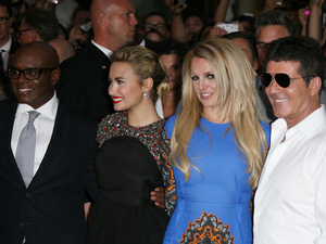 Judges L.A. Reid, Demi Lovato, Britney Spears and Simon Cowell arrive at The X Factor USA Season 2 premiere screening and handprint ceremony at Grauman's Chinese Theater, Los Angeles