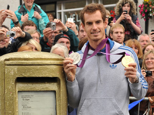 US Open champion and Olympic gold medallist Andy Murray returns to his hometown of Dunblane where fans turned out to cheer him and join him on a walkabout of the