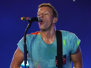 Coldplay perform during the Paralympic Games closing Ceremony at the Olympic Stadium