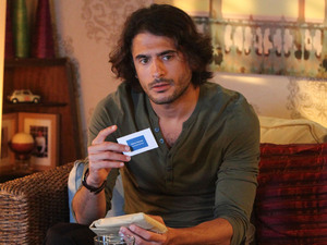 Syed ponders Danny's business card.