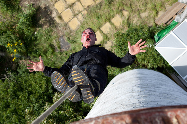 Mick hanging over a lighthouse in Hollyoaks Later